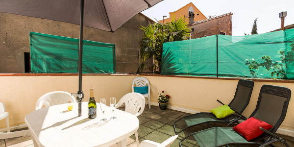 argeles-sur-mer-village-home-terrace-table-umbrella-deckchairs